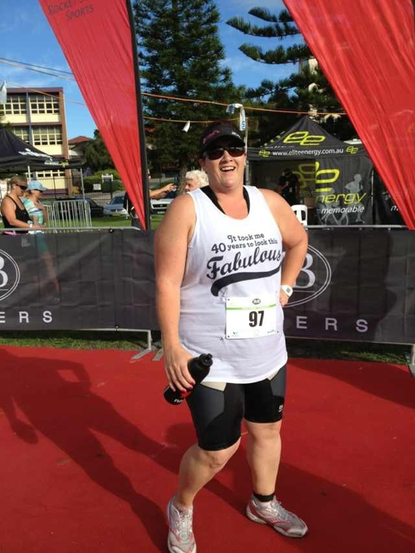 Gasping for air at the finish but somehow still smiling.